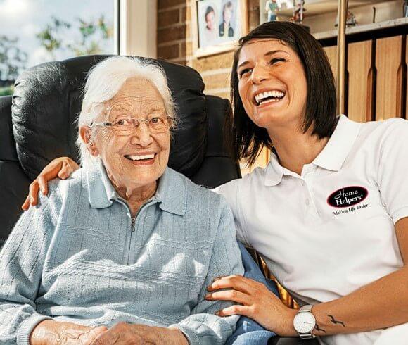 Home Helpers Caregiver holding an elderly woman