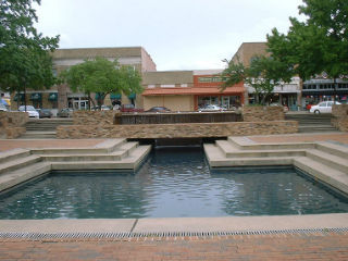 pond in front of a shopping plaza